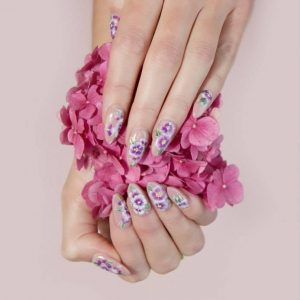 Nail art pink and purple flowers